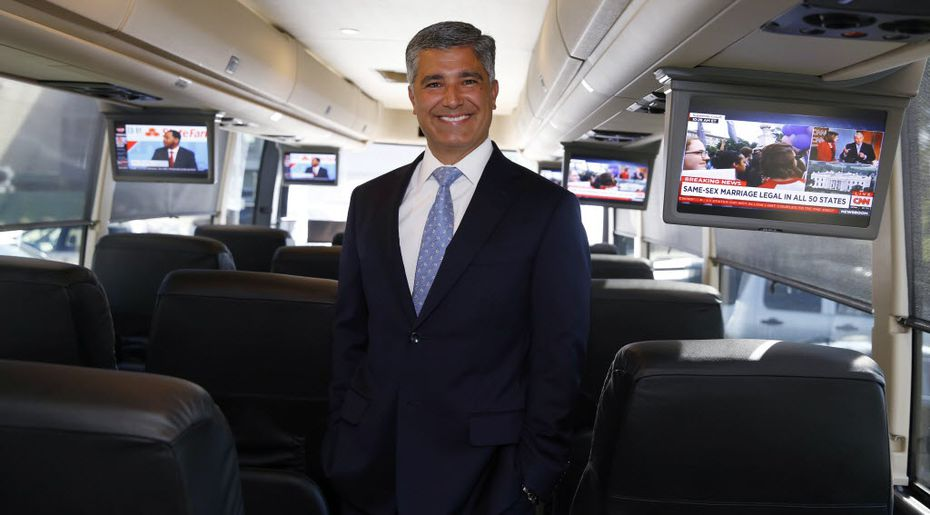 Alex Danza, founder, president and CEO of Vonlane, poses on one of his buses. (David Woo/The Dallas Morning News)