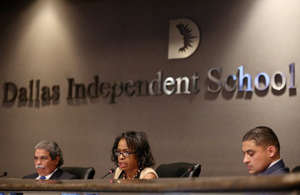 DISD Superintendent Michael Hinojosa (left) and trustee Jaime Resendez (right) listen as trustee Joyce Foreman (center) spoke during a special meeting of the board of trustees last August to decide on calling a tax ratification election.