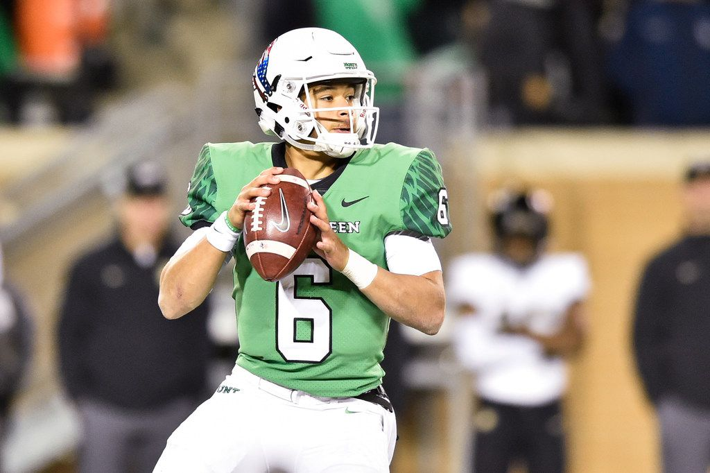 North Texas sophomore quarterback Mason Fine (6) drops back in the pocket and looks for an open receiver, while being defended by the Army defense at Apogee Stadium, Saturday, November 18, 2017, in Denton, Texas, Jeff Woo/DRC