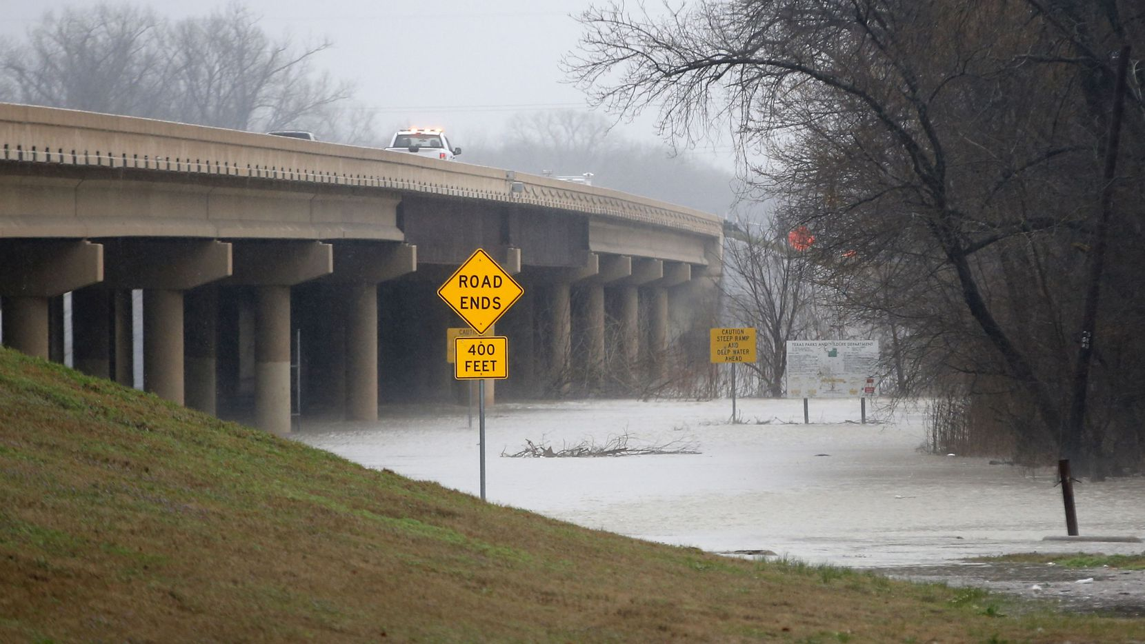 Dallas Fire-Rescue teams respond to a report that a car was swept away from under the Loop 12 bridge at Carbondale Street on Wednesday.