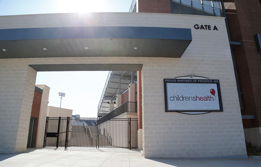 A Children's Health sign is visible from the parking lot at Children's Health Stadium in Prosper ISD.