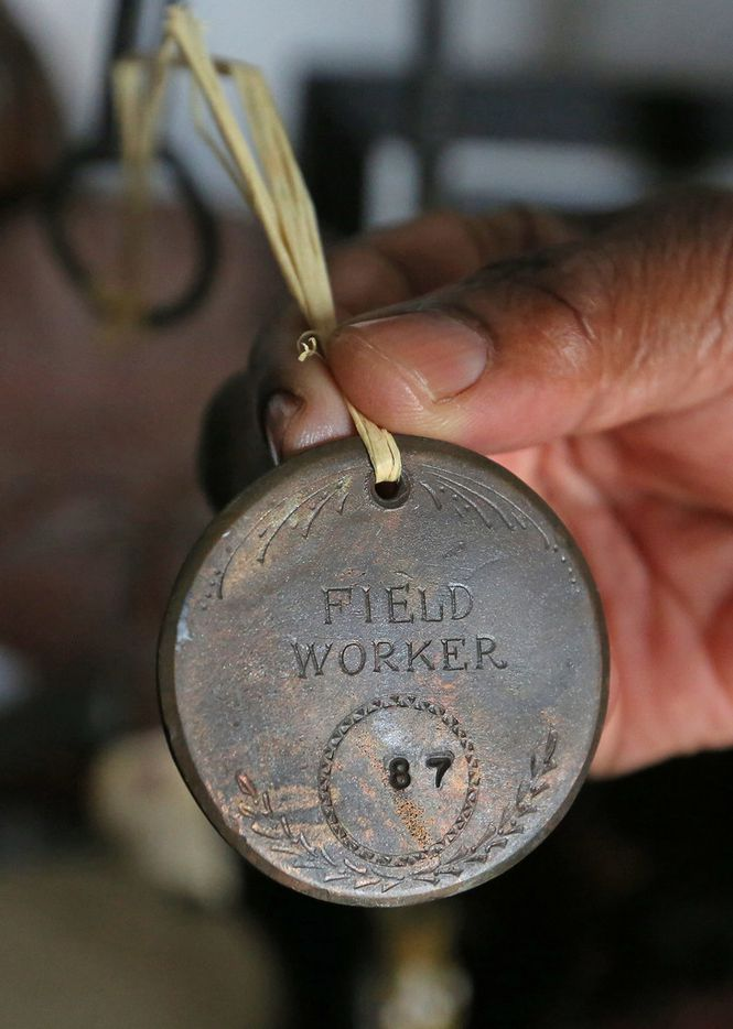 Wanell House shows a medallion worn by a slave, part of her collection of African-American artifacts.