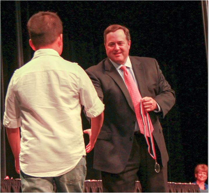 Mel Fuller, a former board president at Northwest ISD, shown here in a 2014 photo presenting the annual NISD Trustee Awards of Excellence. Fuller pleaded guilty in July to possessing vulgar material. He previously resigned from the board.