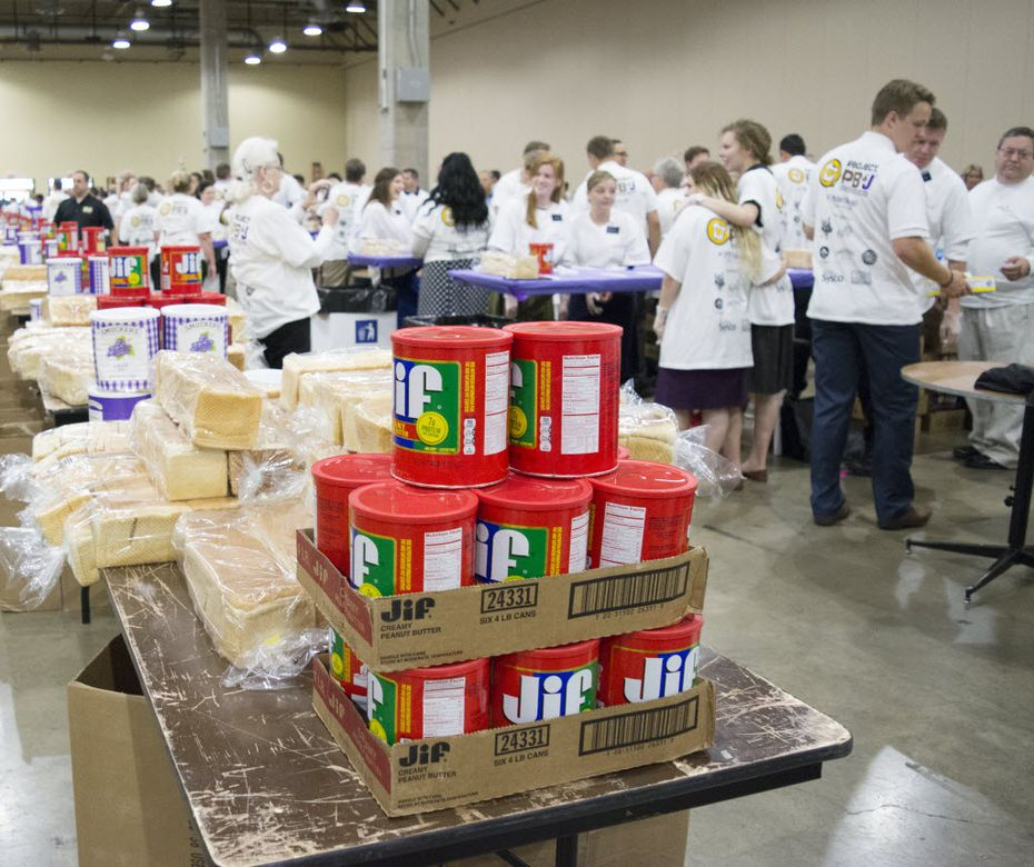 Peanut butter, grape jelly and white bread await being made into PB&J sandwiches as volunteers rush into the Gaylord Texan Convention Center for Which Wich's Guinness World Record Spreading Party.