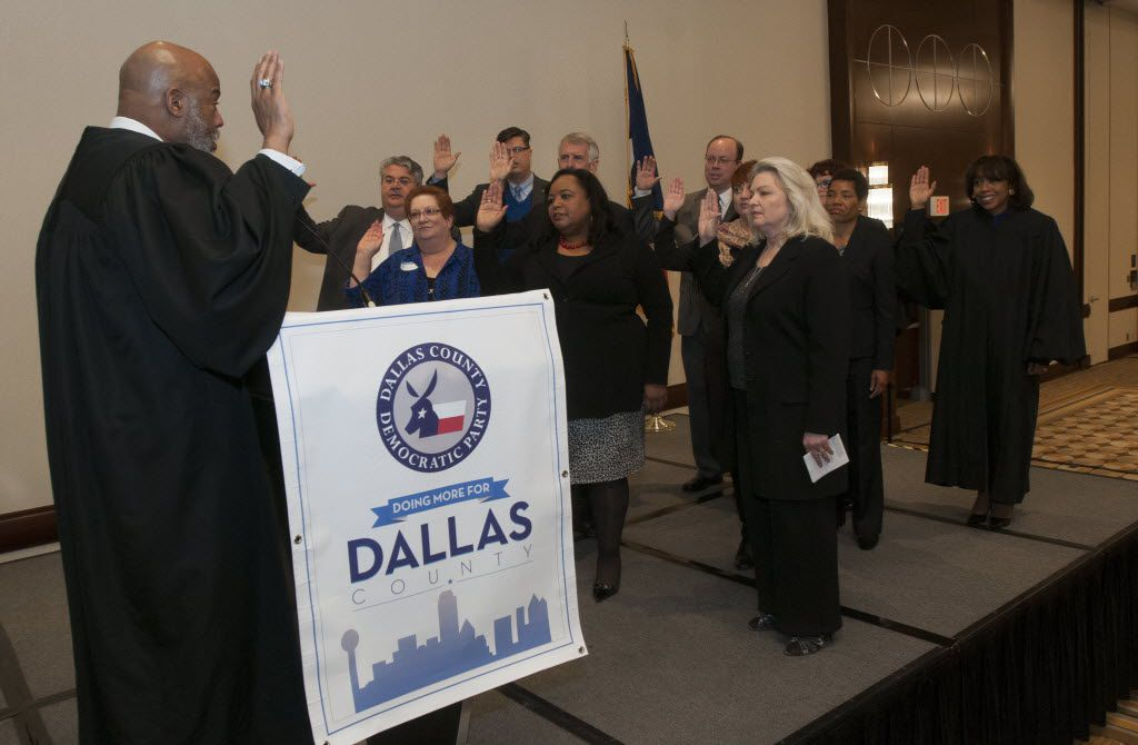 Reelected and new civil court judges are sworn in by 14th Judicial District Court Judge Eric V. Moye at the Hyatt Regency Dallas on Thursday, Jan. 1, 2015.