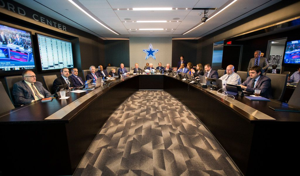 Dallas Cowboys Owner Jerry Jones, center, Head Coach Jason Garrett, center left, CEO and Executive Vice President Stephen Jones, center right, and other Cowboys executives wait to make their first round pick in the war room on Thursday, April 26, 2018 at The Star in Frisco, Texas. (Ashley Landis/The Dallas Morning News)