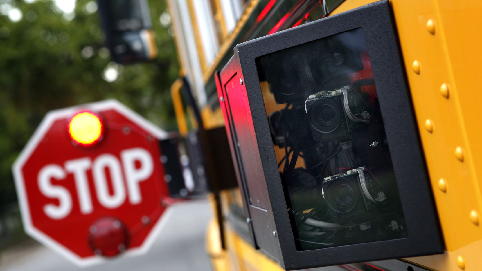 A new Dallas County Schools bus which has cameras on the outside near the stop-arm to catch drivers who fail to halt at Dallas County Schools Administration building in Dallas on Wednesday, August 18, 2010. (Lara Solt/The Dallas Morning News) 08232010xMETRO