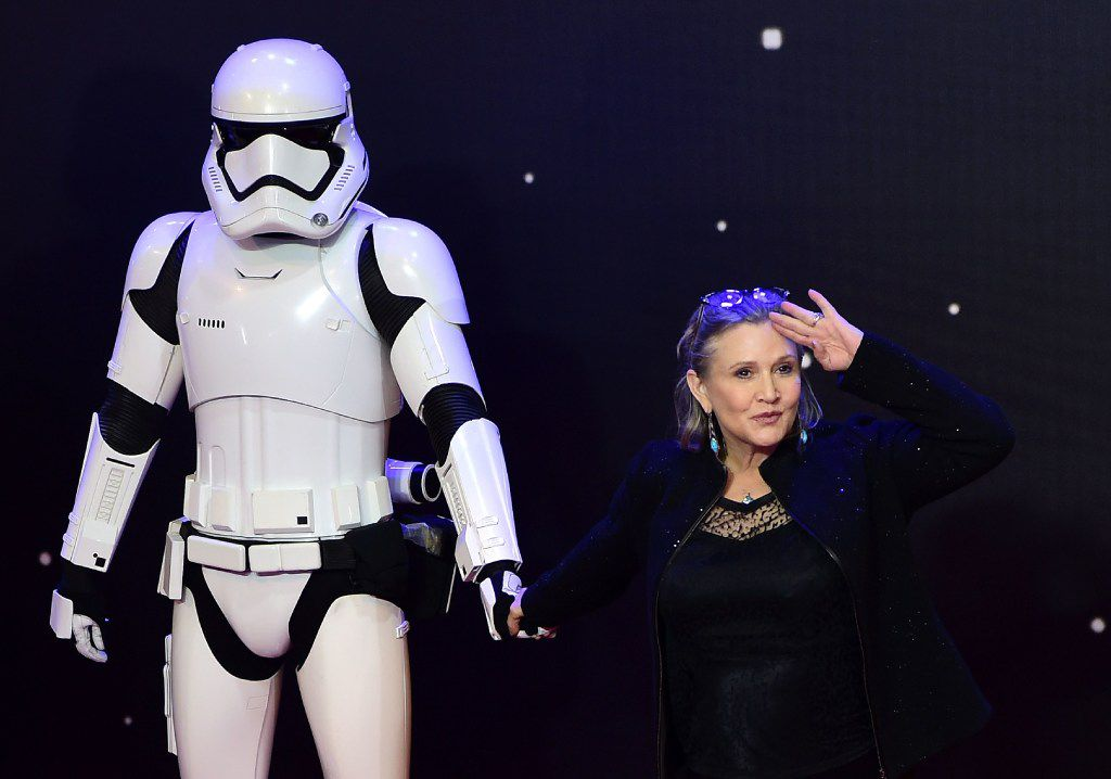 "Carrie Fisher posed with a storm trooper at the European premiere of ""Star Wars: The Force Awakens"" in central London in 2015."