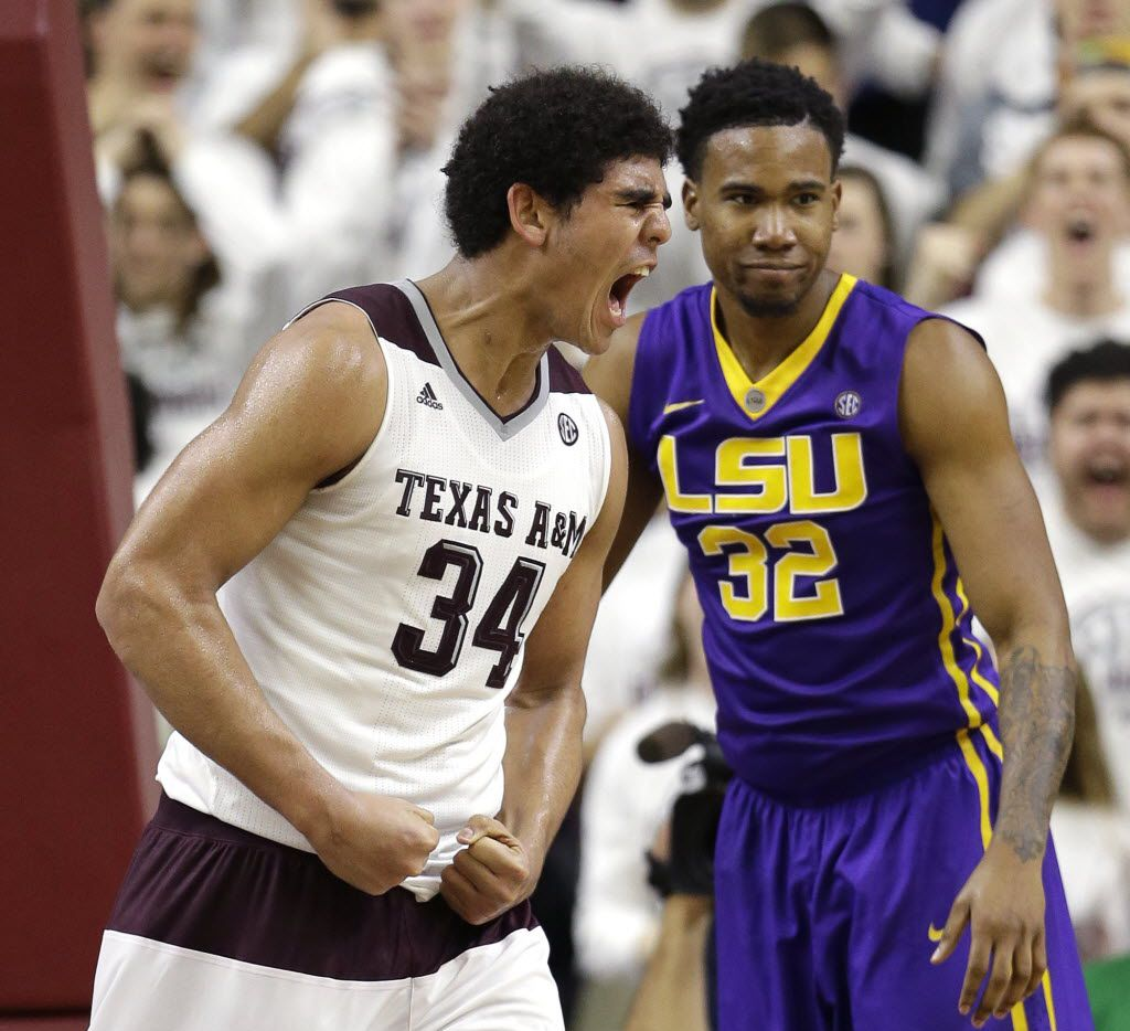 Texas A&M's Tyler Davis (34) yells after making a basket while being fouled, as LSU's Craig Victor II (32) reacts during the second half of an NCAA college basketball game Tuesday, Jan. 19, 2016, in College Station, Texas. (AP Photo/David J. Phillip)