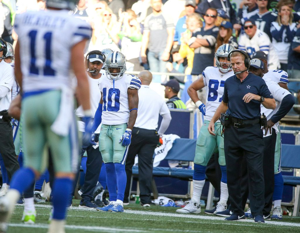 Dallas Cowboys wide receiver Tavon Austin (10) and head coach Jason Garrett look on as Earl Thomas bows after intercepting a Dak Prescott pass during the second half of an NFL game between the Dallas Cowboys and Seattle Seahawks on Sunday, September 23, 2018 at CenturyLink Field in Seattle. (Shaban Athuman/The Dallas Morning News)