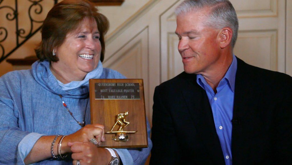 Mary Templeton brandishes her high school ski team MVP award to her husband, Rich, Texas Instruments' chairman, as part of a video announcing that the couple will spearhead United Way's 2018-19 fundraising drive.
