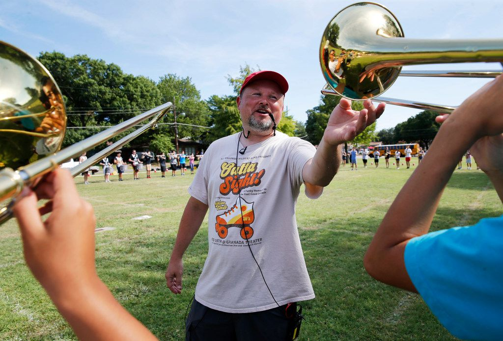 Woodrow Wilson band director Chris Evetts coaches band students during practice at Woodrow Wilson High School in Dallas, on Aug. 7, 2018. (Vernon Bryant/The Dallas Morning News)