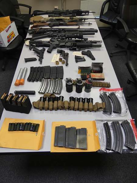 Police reported finding a number of weapons and accessories.