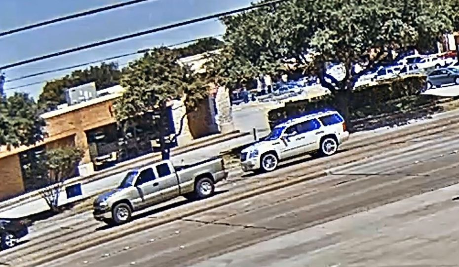 Surveillance footage from a business shows what appears to be a man throwing something from the open window of an Escalade at a truck in the 1300 block of Northwest Highway on Aug. 22.