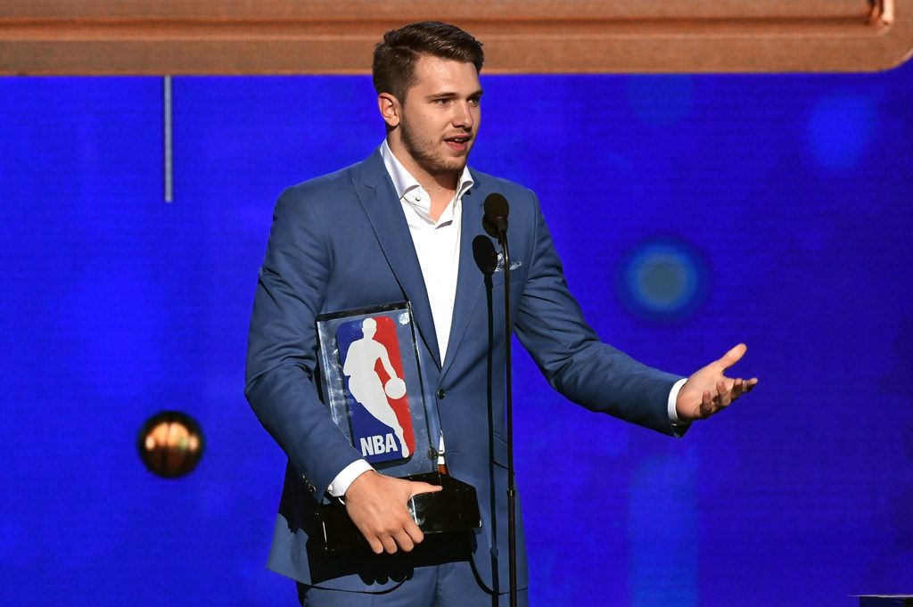 SANTA MONICA, CALIFORNIA - JUNE 24: Luka Doncic accepts the Kia NBA Rookie of the Year award onstage during the 2019 NBA Awards presented by Kia at Barker Hangar on June 24, 2019 in Santa Monica, California. (Photo by Kevin Winter/Getty Images for Turner Sports)