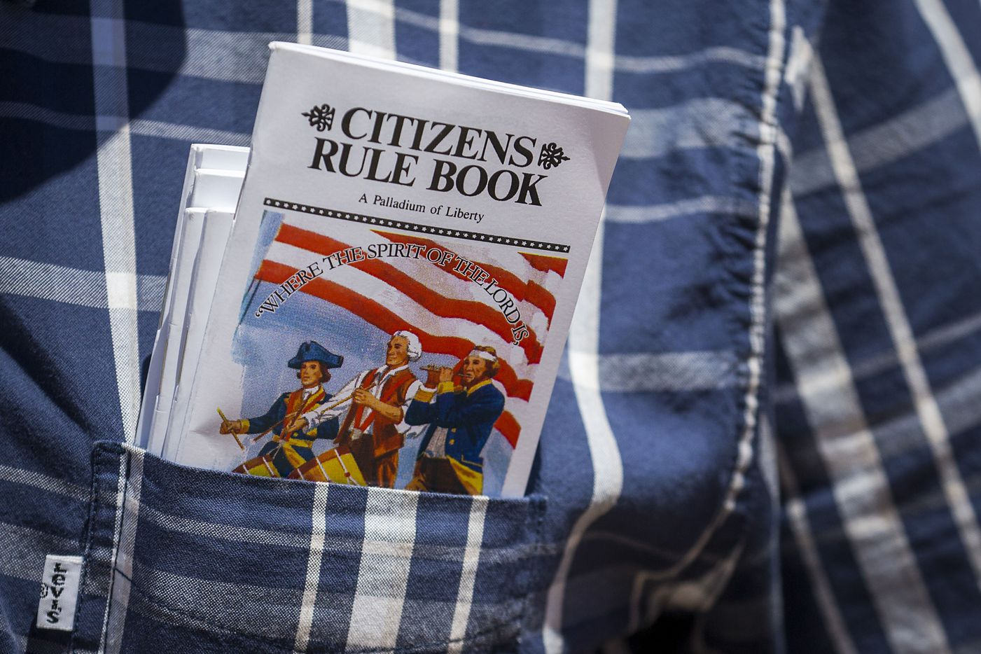 """A gun rights advocate carries copys of the """"Citizens Rule Book"""" in his pocket while demonstrating outside Dallas City Hall at a rally organized by Open Carry Texas during the NRA Annual Meeting & Exhibits at the Kay Bailey Hutchison Convention Center on Saturday, May 5, 2018, in Dallas."""