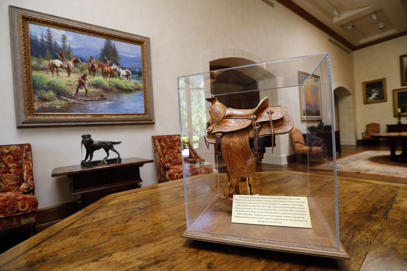 A small saddle once owned by President Ronald Reagan was given to T. Boone Pickens by Nancy Reagan and is now on display in the art gallery.