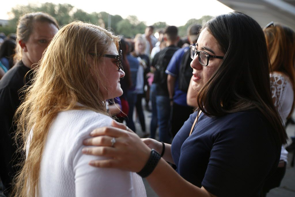 Lucia Gonzalez, (left) Janeera Gonzalez' mother is hugged by a Rocio Ramirez during a memorial held for Janeera Gonzalez, the North Lake College student slain Wednesday, at Irving High School in Irving, Texas on May 8, 2017.