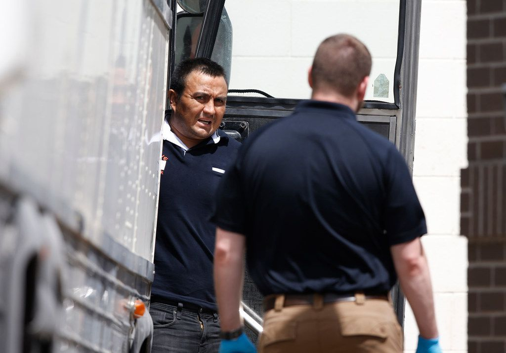 Detained immigrants unload from buses at the federal courthouse in McAllen, Texas, on June 11, 2018. Many more immigrants who cross the border without authorization are now being charged with a crime. They face mass court appearances where most plead guilty.