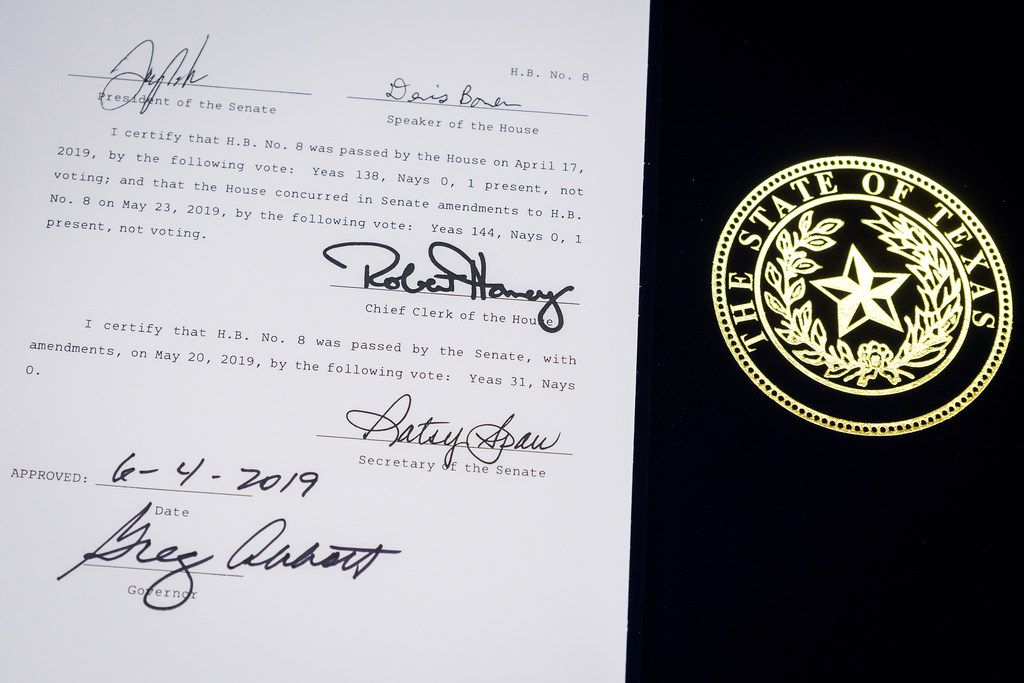 House Bill 8 is displayed with the signature of Governor Greg Abbott following a bill signing ceremony at New Friends New Life on Tuesday, June 4, 2019, in Dallas.