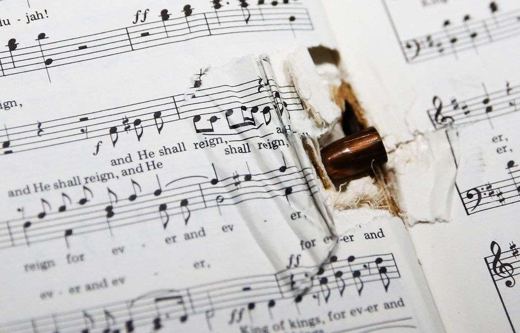 A bullet lodged in the spine of a hymnal was among items in a special display on the shootings set up at Wedgwood.