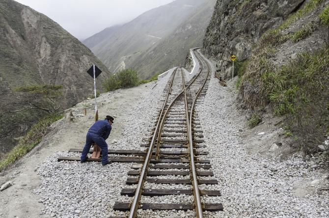 Crew members conduct safety checks before Tren Crucero navigates the notorious Devil's Nose via a series of extreme switchbacks.
