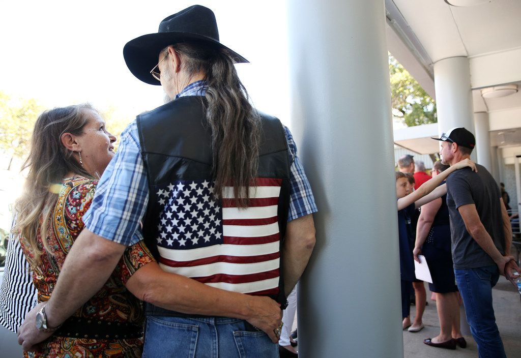 Cherri Coiner, of Amarillo, Texas, and Ken Summers, of Lubbock, Texas wait for the arrival of President Donald Trump before Trump's visit to Dallas while at Dalfort Fueling near Love Field in Dallas Wednesday October 25, 2017. President Trump will participate in a hurricane recovery briefing, a Republican National Committee roundtable and give remarks at a reception. (Andy Jacobsohn/The Dallas Morning News)