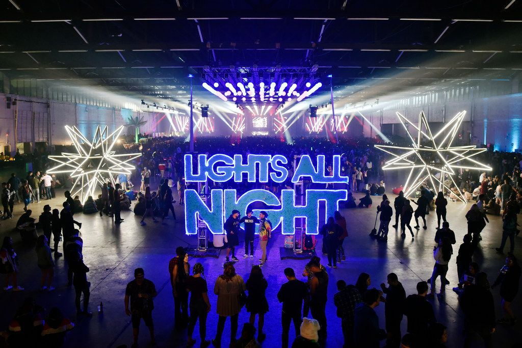 Signage at 'Lights All Night' illuminates Dallas Market Hall on Friday, Dec. 28, 2018.