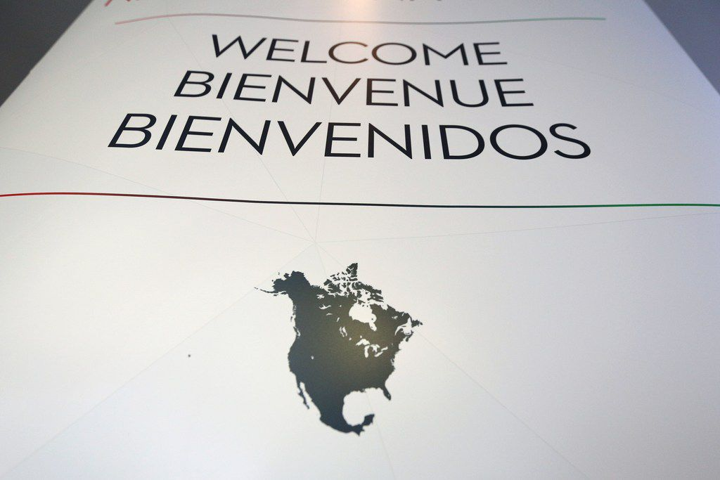 """(FILES) This file photo taken on September 24, 2017 shows a welcome sign seen during the third round of the NAFTA renegotiations in Ottawa, Ontario. The business world is mobilizing to convince the Trump administration to save the North American Free Trade Agreement, which corporate leaders say has greatly benefited the world's largest economy for 23 years. With televised ads proclaiming """"NAFTA works for America"""" and study after study enumerating the dangers of withdrawing from the treaty, the US Chamber of Commerce and like-minded trade proponents have taken their message to Capitol Hill.  / AFP PHOTO / Lars HagbergLARS HAGBERG/AFP/Getty Images"""