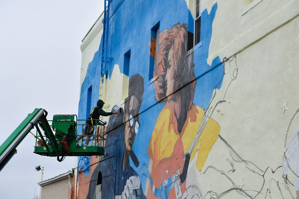 """Local artist Dan Black paints his mural called """"Band on the Run"""" on the outside wall of Andy's Bar & Grill on the Denton Square near the intersection of North Locust Street and East Oak Street. Black described the music-themed mural as a showcase of 1940s and 1950s motorcycle culture. He said he should be finished with it around the middle of next week. Some of Black's art also can be seen around Denton at places such as Bullseye Bike Shop, West Oak Coffee Shop and the Discover Denton Welcome Center., Wednesday, December 6, 2017, in Denton, Texas, Jeff Woo/DRC"""