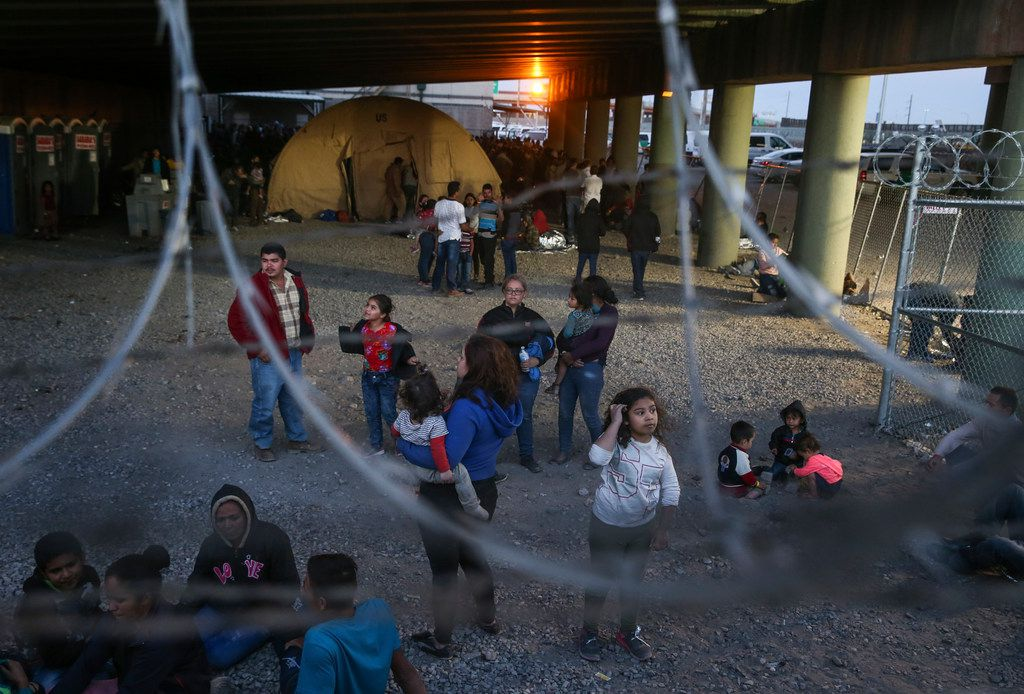 Migrants, including young children and babies, seeking asylum are seen in a U.S. Border Patrol temporary holding area under the Paso Del Norte bridge in El Paso on March 29, 2019.