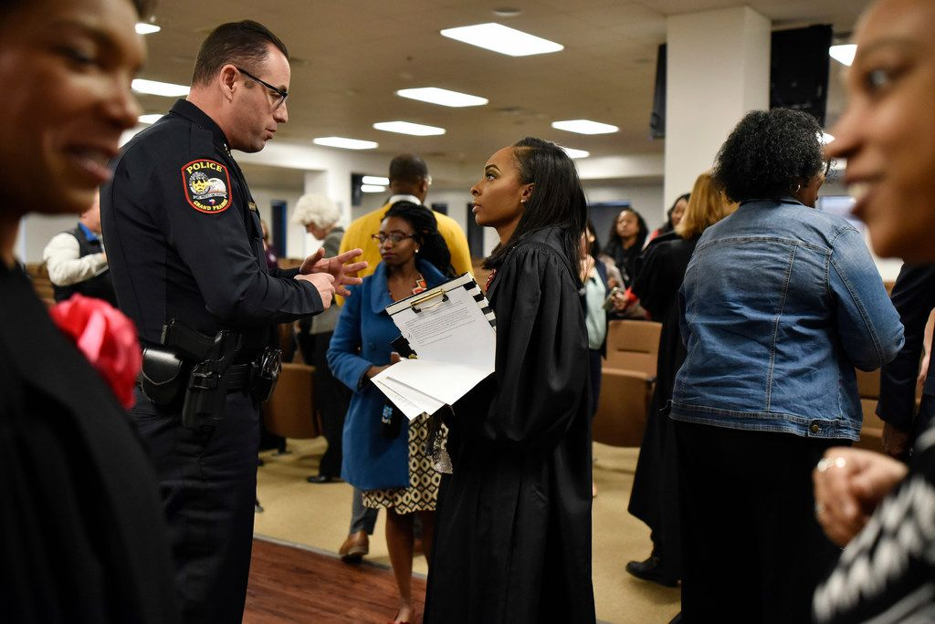 "Grand Prairie Assistant Police Chief Daniel Scesne and Dallas County Criminal Court Judge Shequitta Kelly talked Tuesday after her news conference about the ""Bring 'EM Back"" gun program."