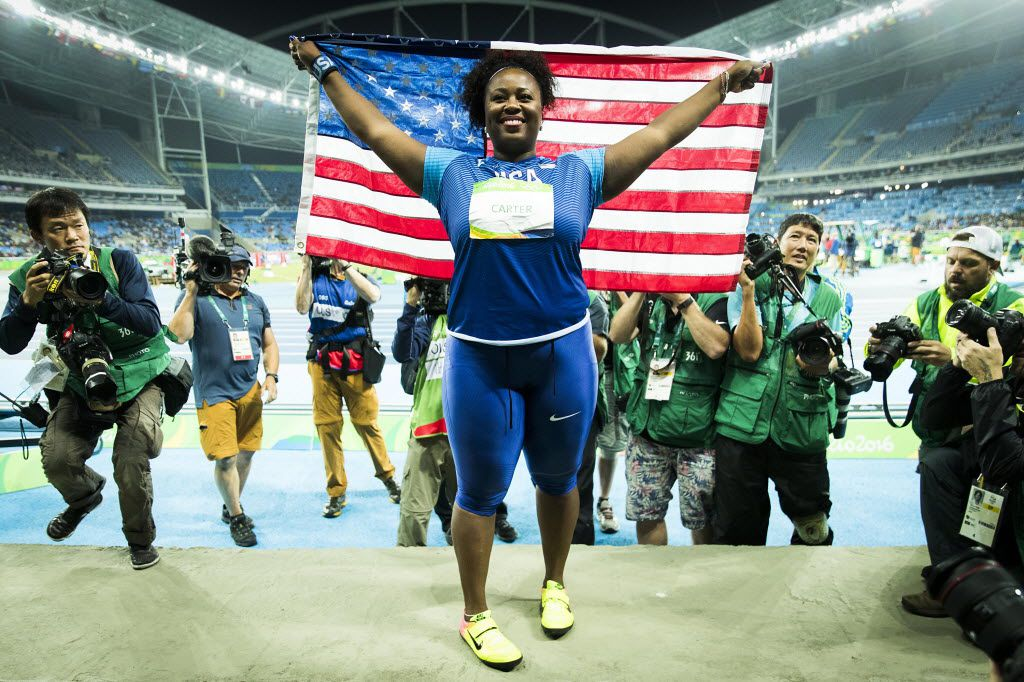 FILE - Michelle Carter celebrates after winning the women's shot put gold medal on the first day of track and field at the Rio 2016 Olympic Games on Friday, Aug. 12, 2016, in Rio de Janeiro. (Smiley N. Pool/The Dallas Morning News)