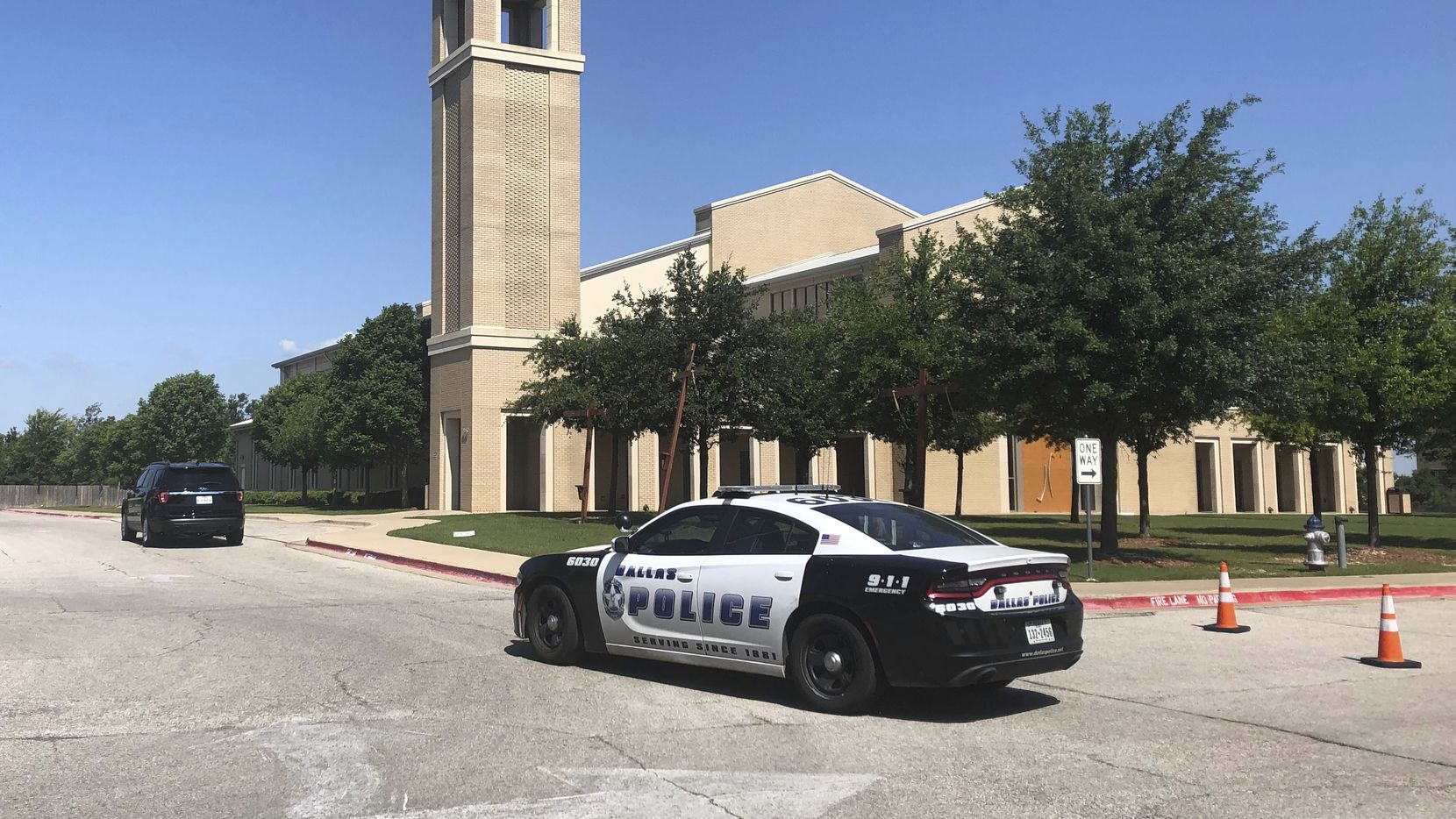 A police car was parked outside St. Cecilia Catholic Church on Wednesday.