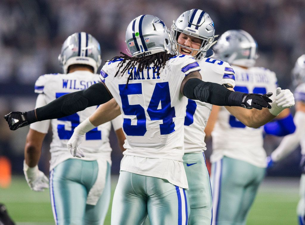 Dallas Cowboys middle linebacker Jaylon Smith (54) and outside linebacker Leighton Vander Esch (55) celebrate after running Seattle Seahawks quarterback Russell Wilson (3) off the sideline during the first quarter of an NFL playoff game between the Dallas Cowboys and the Seattle Seahawks on Saturday, January 5, 2019 at AT&T Stadium in Arlington, Texas. (Ashley Landis/The Dallas Morning News)