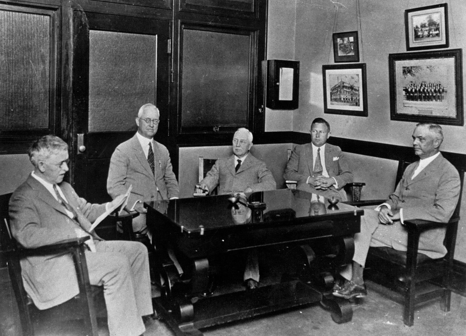 Directors of A. H. Belo & Co. (from left) Tom Finty Jr., John F. Lubben, G.B. Dealey, Walter A. Dealey and Ennis Cargill convene a session in the office of G.B. Dealey on Sept. 22, 1925, just prior to the 40th anniversary of The Dallas Morning News. A year later, G.B. Dealey bought a majority interest in A. H. Belo & Co.