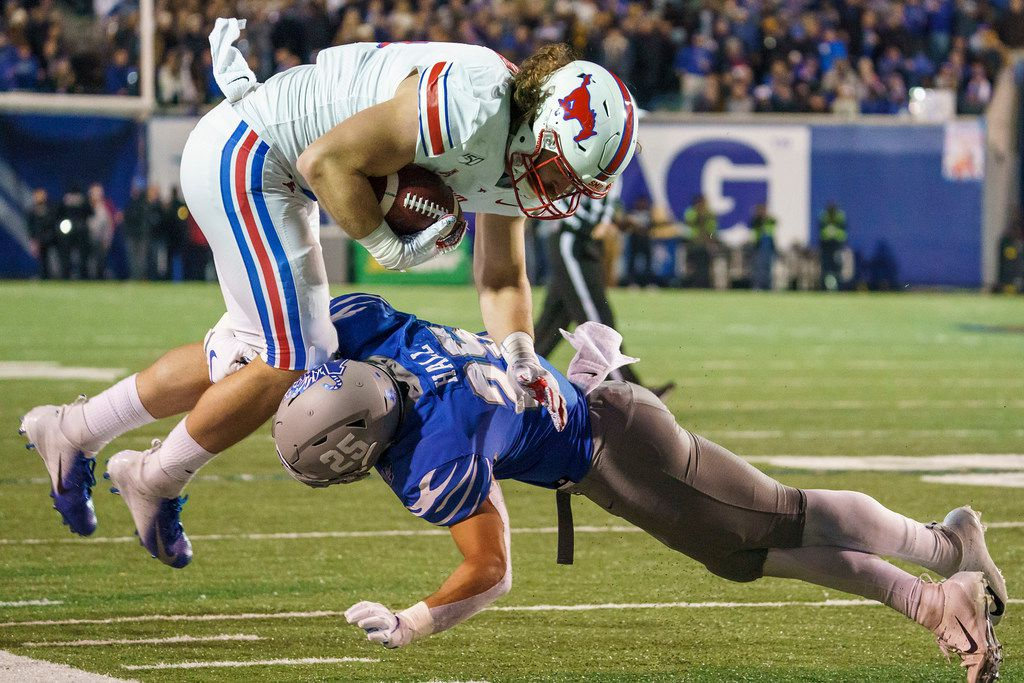 SMU tight end Ryan Becker (14) is knocked off his feet by Memphis linebacker Austin Hall (25) during the second half of an NCAA football game at Liberty Bowl Memorial Stadium on Saturday, Nov. 2, 2019, in Memphis, Tenn. (Smiley N. Pool/The Dallas Morning News)