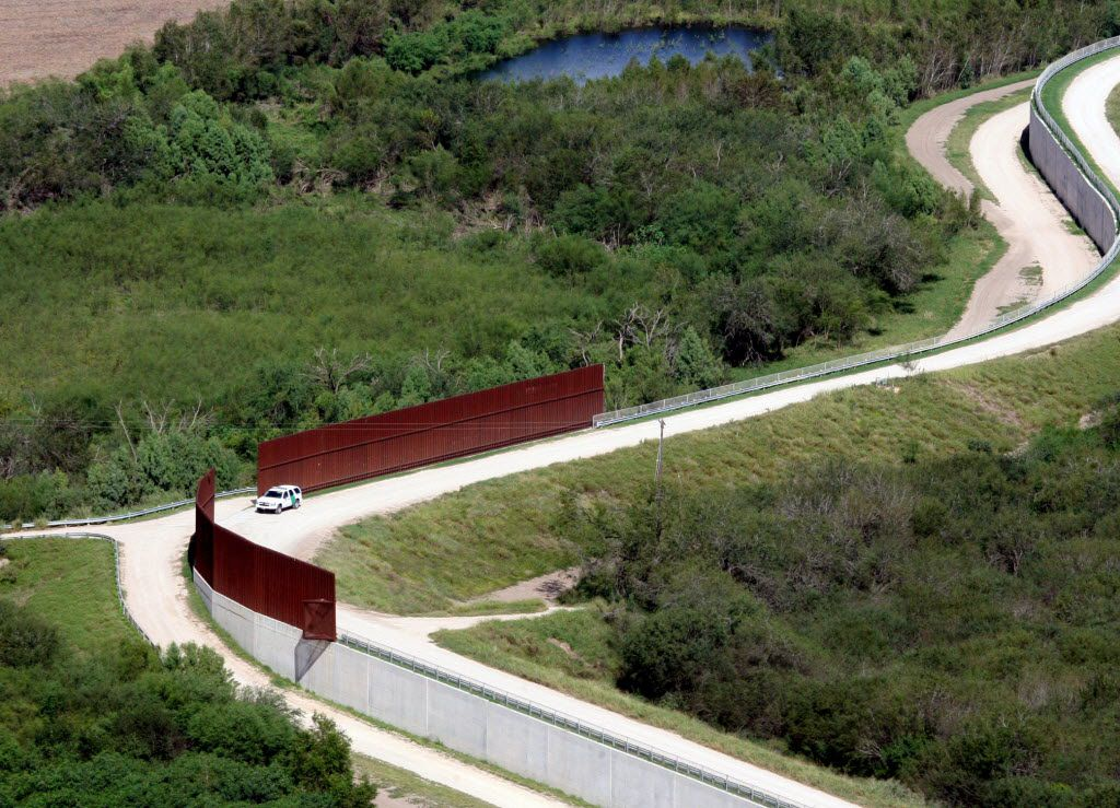 FILE - In this Nov. 16, 2015, aerial file photo, a U.S. border patrol vehicle appears near the border wall near Abram, Texas, from a U.S. Customs and Border Protection helicopter. Nearly 5,000 unaccompanied immigrant children were caught illegally crossing the U.S. border with Mexico in October, almost double the number from October 2014, according to U.S. Customs and Border Protection data. Also, in the figures released Tuesday, the number of family members crossing together nearly tripled from October 2014 — from 2,162 to 6,029. (Delcia Lopez/The Monitor via AP)