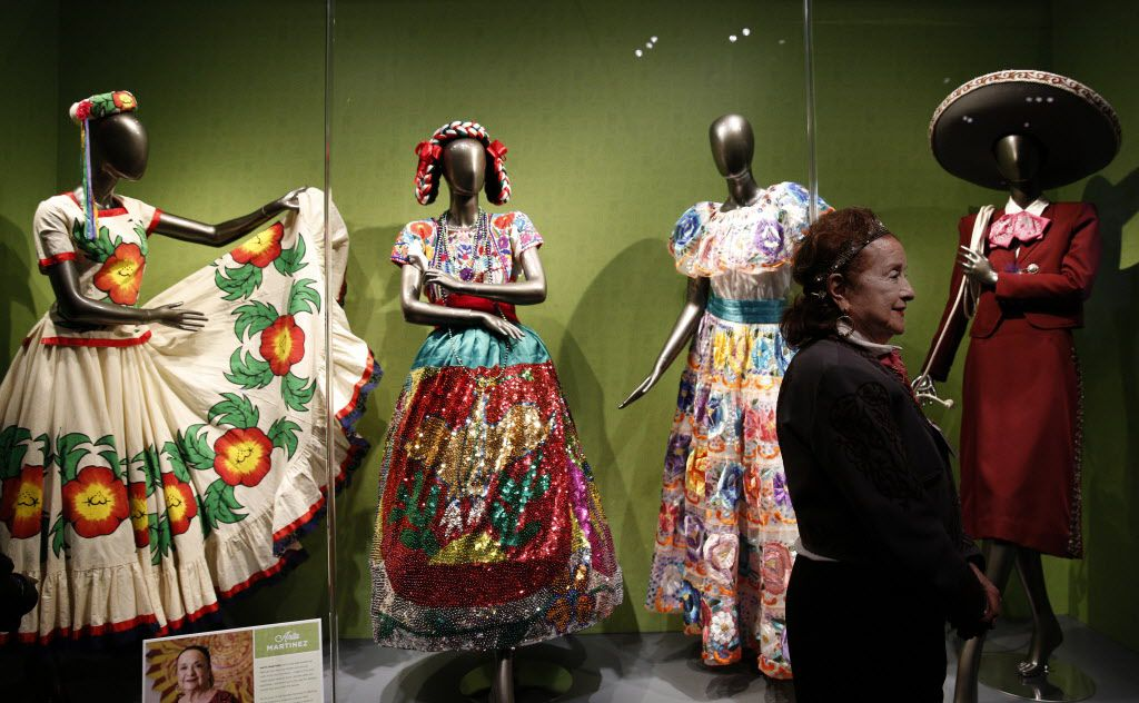 Anita Martinez stands next to her collection traditional ballet folklorico, part of the Eye of the Collector exhibit at the Perot Museum of Nature and Science in Dallas on April 14, 2016.