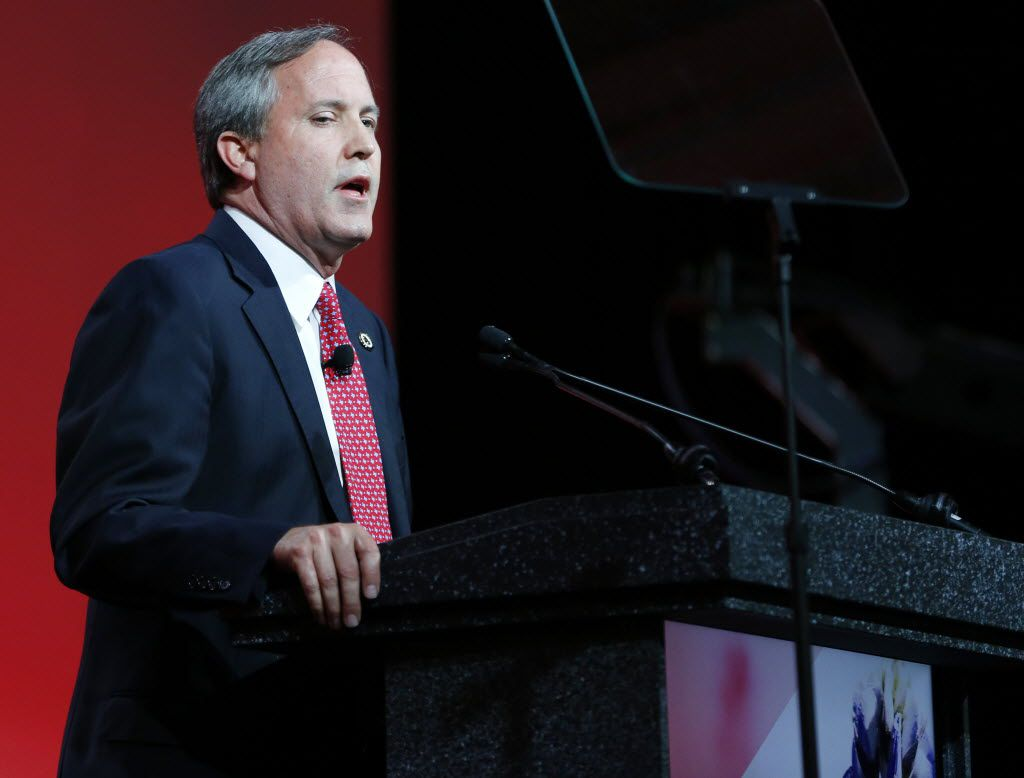 Texas Attorney General Ken Paxton speaks to the crowd during the 2016 Texas Republican Convention at the Kay Bailey Hutchison Convention Center in Dallas.