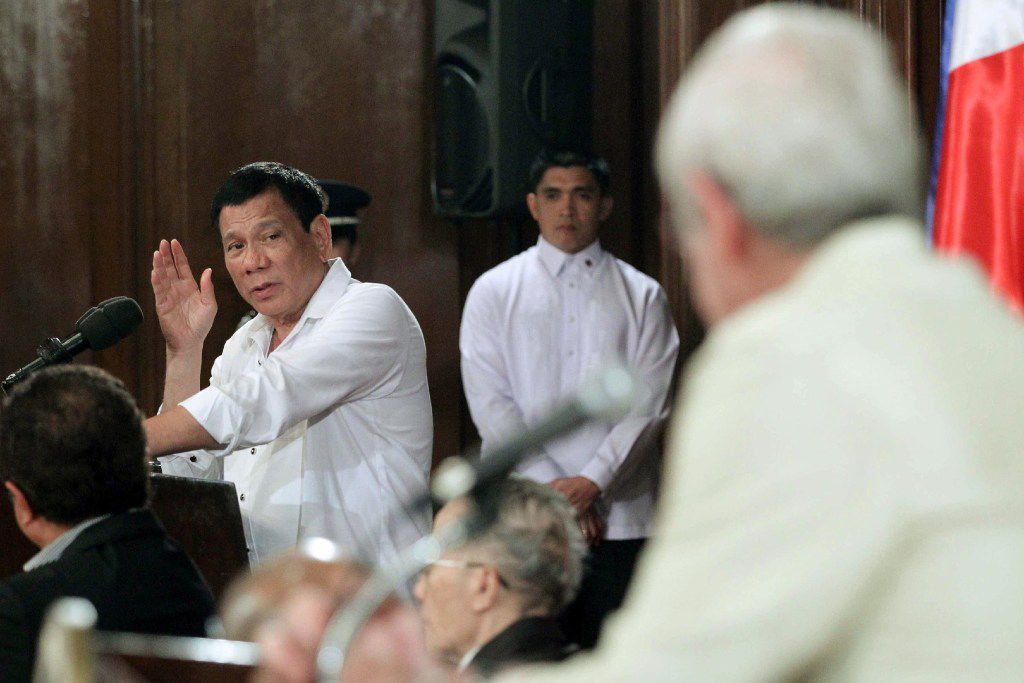 Philippine President Rodrigo R. Duterte (R) gesturing while answering a question during a forum with local and foreign businessmen at Malacanang Palace in Manila.