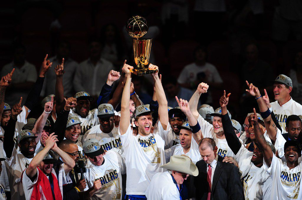 (FILES) In this file photo taken on June 12, 2011 Dirk Nowitzki (C) of the Dallas Mavericks celebrates with teammates after winning the NBA Finals against the Miami Heat at the AmericanAirlines Arena in Miami, Florida. - Dallas Mavericks star Dirk Nowitzki confirmed his retirement from the NBA on April 10, 2019, calling time on a 21-season career that saw him become the greatest European player ever to grace the league. (Photo by Mark RALSTON / AFP)MARK RALSTON/AFP/Getty Images