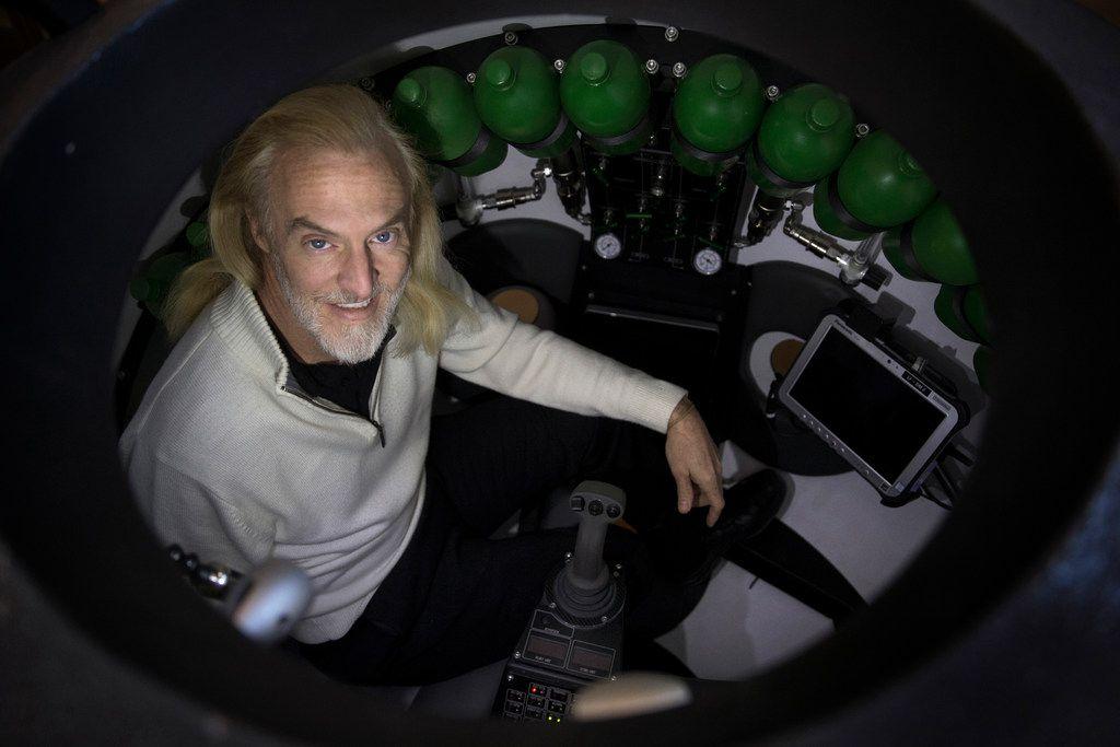 Victor Vescovo poses for a photograph in his Triton 36000/2 submersible simulator at his home in Dallas.
