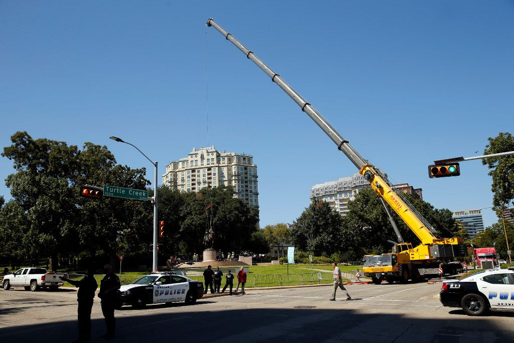 Crewman from Howell Crane and Rigging, Inc attempt to remove the Robert E. Lee statue from Robert E. Lee Park in Dallas, Wednesday, September 6, 2017. Earlier in the day the Dallas City Council voted 13-1 for immediate removal of the monument to the Confederate general with a soldier at his side. The removal was halted though by a temporary restraining order from U.S. District Judge Sidney A. Fitzwater. (Tom Fox/The Dallas Morning News)