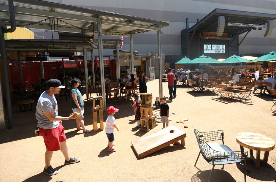 Patrons can play with building blocks and other outdoor games at the Box Garden at Legacy Hall.