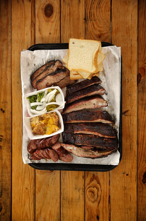 A tray full of smoked sausage, ribs and brisket (and peach cobbler) at Corkscrew BBQ, 24930 Budde Rd.  in Spring, Texas Friday, June27, 2014. (Tom Fox/The Dallas Morning News) 12302014xARTSLIFE 12312014xBRIEFING