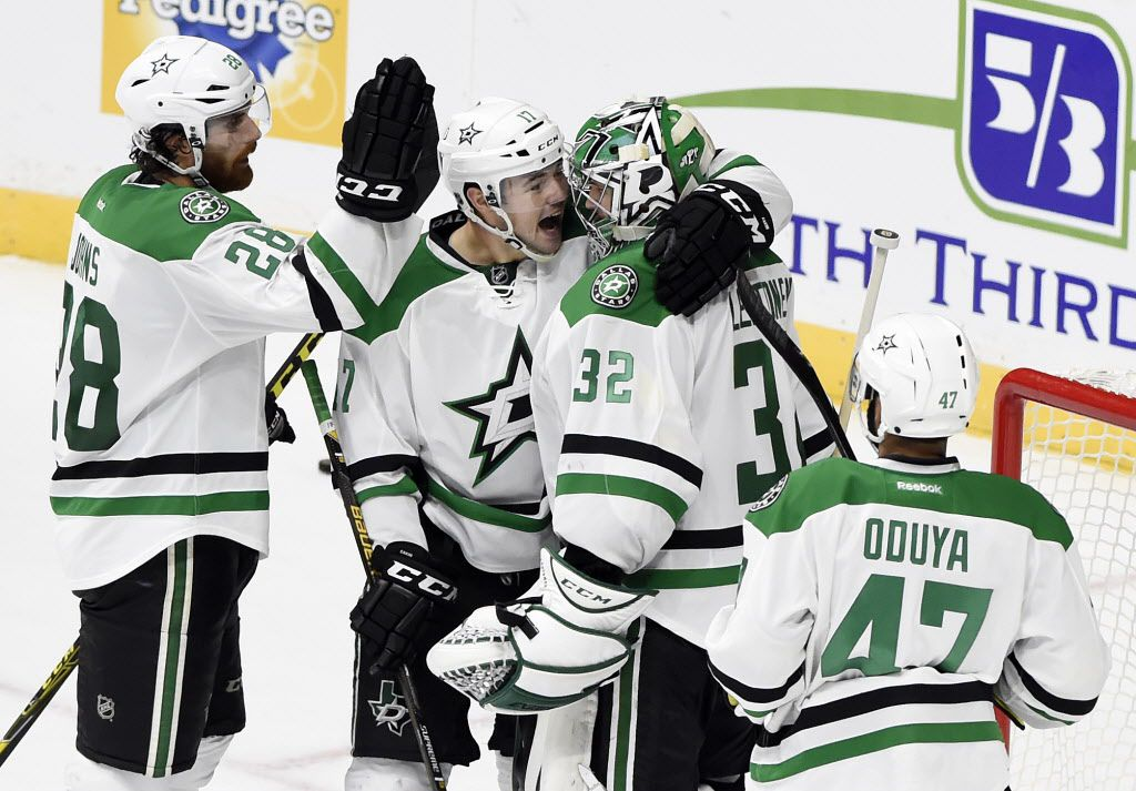 Dallas Stars' Stephen Johns (28), Devin Shore (17), and Johnny Oduya (47), of Sweden, congratulate goalie Kari Lehtonen (32), of Finland, after the Stars defeated the Nashville Predator 2-1 in an NHL hockey game, Tuesday, Oct. 18, 2016, in Nashville, Tenn. (AP Photo/Mark Zaleski)