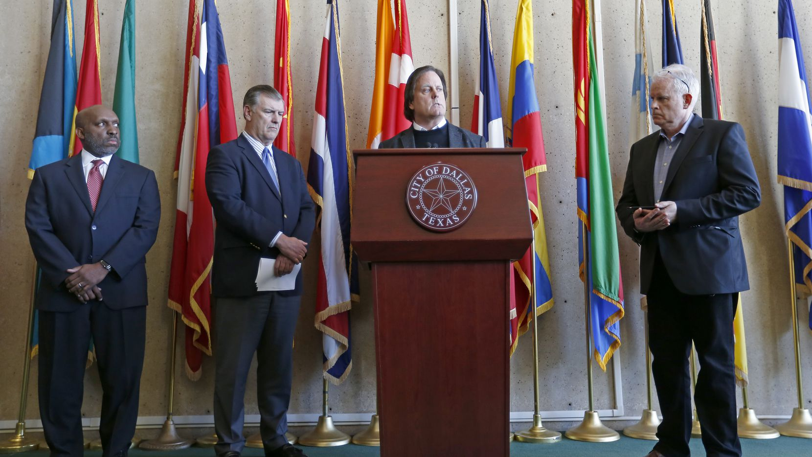 David R. Carey, executive vice president of T-Mobile, speaks at a recent news conference related to Dallas 911 problems as (from left) City Manage, T.C. Broadnax, Mayor Mike Rawlings  and Neville R. Ray, executive vice president and chief technology officer of T-Mobile, listen.