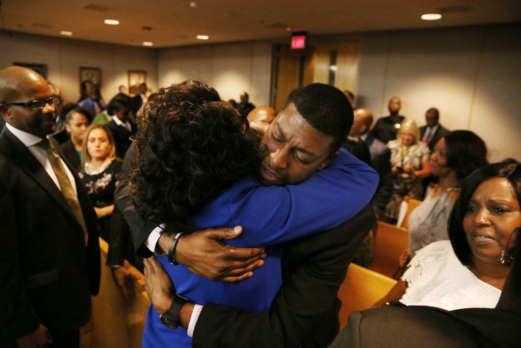 Odell Edwards gets a hug from Dallas County district attorney Faith Johnson following Tuesday's guilty verdict in the murder trial of Roy Oliver, the former Balch Springs police officer who fatally shot Edwards' 15-year-old son, Jordan, last year.