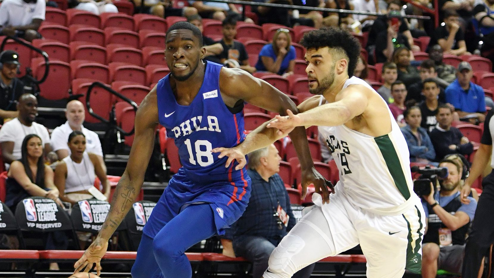 LAS VEGAS, NEVADA - JULY 05:  Shake Milton #18 of the Philadelphia 76ers drives under pressure from Elijah Bryant #19 of the Milwaukee Bucks during the 2019 NBA Summer League at the Thomas & Mack Center on July 5, 2019 in Las Vegas, Nevada. The 76ers defeated the Bucks 107-106. NOTE TO USER: User expressly acknowledges and agrees that, by downloading and or using this photograph, User is consenting to the terms and conditions of the Getty Images License Agreement.  (Photo by Ethan Miller/Getty Images)